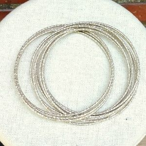 Jewelry - Textured intertwined silver bangles